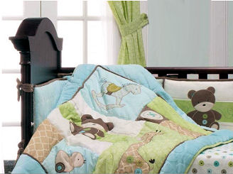 Baby boy nursery room with rocking horse teddy bear crib quilt and bedding