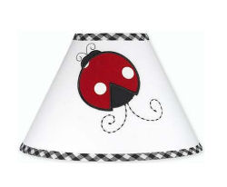 Ladybug wall decals decorating a plain white lamp shade for a baby girl nursery