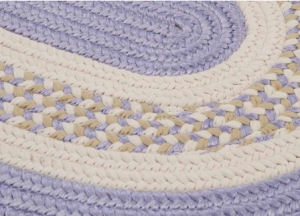 Lavender cream and sage green braided area rug for the baby nursery room