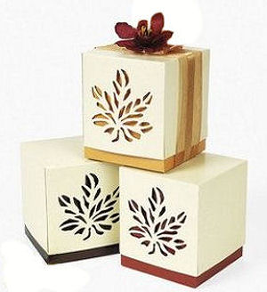 DIY fall themed baby shower party favor gift boxes decorated with leaf stencil pattern