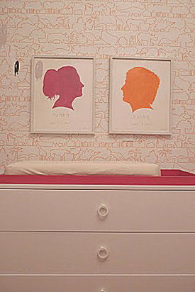 Pink and orange framed Jonathan Adler silhouette nursery wall art
