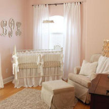 Elegant antique white wooden wall monogram with a baby girl's initials for a pale pink nursery wall