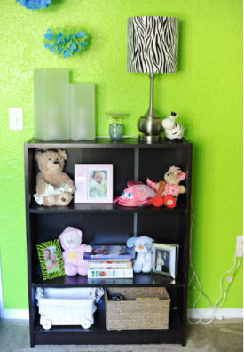 Nursery bookshelf with zebra print decorations