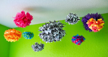 Colorful tissue paper pom poms nursery ceiling decorations in zebra print and other bright colors