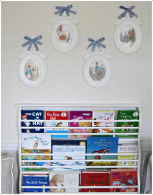 Books on display in a little prince's nursery reading nook