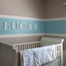Light taupe baby blue and cream nursery wall paint colors used to paint stripes