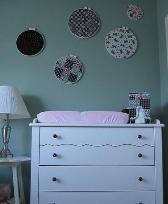 PInk and White Baby Changing Table with Black and White Polka Dot Drawer Pulls w Vintage Fabric Wall Decorations