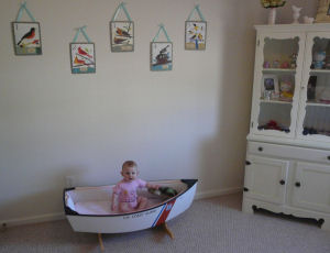 Shabby chic baby girl nursery room with sailboat decor