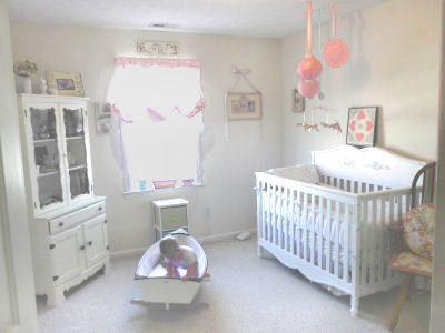 Our baby girl, Magnolia's shabby chic nursery in pink with a vintage sailboat that she loves to play with.