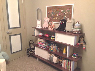 Baby Boy modern monster theme nursery room with white and walnut brown Oeuf furniture Ugly Doll and Bla Bla items and a giant Zook