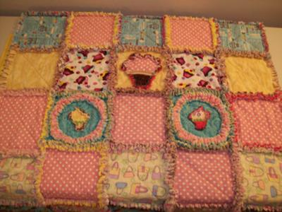 A colorful baby girl's cupcake theme rag quilt would make a lovely personalized baby shower or birthday gift!