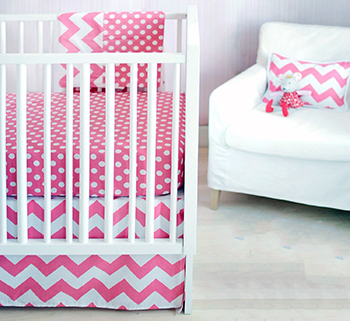 Modern hot pink baby girl bedding with  pink and white zig zag chevron fabric for the nursery
