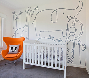 Modern jungle animals safari gender neutral baby nursery room theme decor in grey white and orange