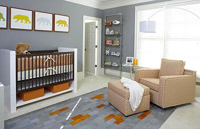 A modern baby bear theme nursery in bright colors including orange, blue gold and green designed by Karen Hott Interiors with photos by Lauren Rubinstein.