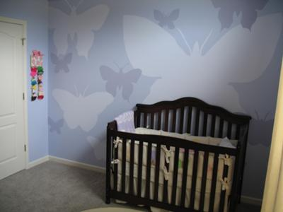 Modern Butterflies theme nursery wall painted in shades of blue for our baby girl, Lily.
