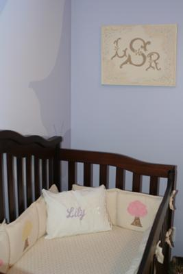 The monogram painting with Lily's Initials and her baby bedding