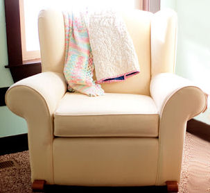 Neutral color upholstered nursery rocker glider