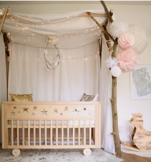Celestial moon and stars baby nursery decorating ideas wooden handmade star themed baby crib and sparkling lights.