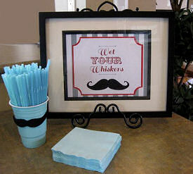 Little man mustache baby shower table decorations in baby blue for a boy
