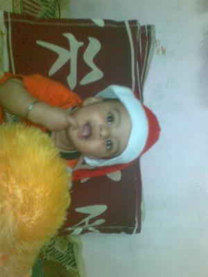 MY SMILING BABY wearing a SANTA HAT!