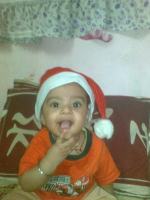 MY SMILING BABY BOY in  his SANTA CLAUS HAT!