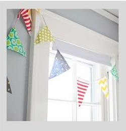Fabric baby pennant flags banner with chevron stripes and polka dots in a shared nursery