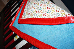DIY Homemade Nautical Baby Crib Quilt made using minky fabric and fabric with an anchor pattern