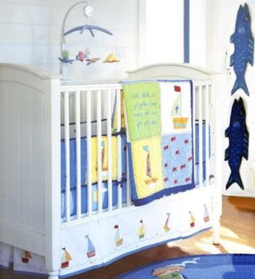 Secondhand nautical sailboat theme baby bedding and decor that was barely used!