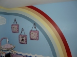 Rainbow painting in a Noah s Ark baby nursery for twins
