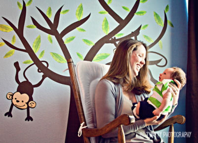 Baby boy monkey nursery theme with a tree wall mural and blue wall paint color