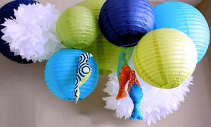 Colorful nursery ceiling mobile in a fish theme nursery for a baby girl or boy