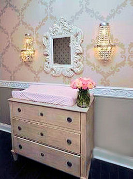 Vintage painted baby dresser with crystal pulls in a baby girl nursery room