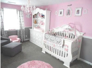 White nursery chair rail wainscoting in a pink and grey baby girl princess nursery