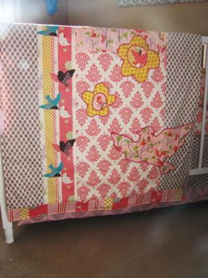 Baby crib quilt made using fabric from the