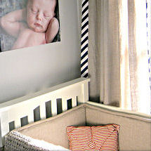 Baby boy vintage nursery theme with chevron stripe print baby bedding and curtains