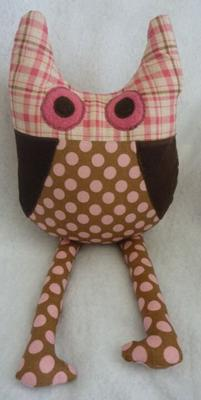 Pink and brown owl themed nursery pillow made with fabrics from pink and brown polka dots and plaid pattern fabrics that complement my baby girl's owl baby bedding set.