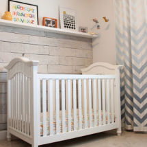 Neutral gray and white nursery with chevron curtains and recycled wood pallet wall decor