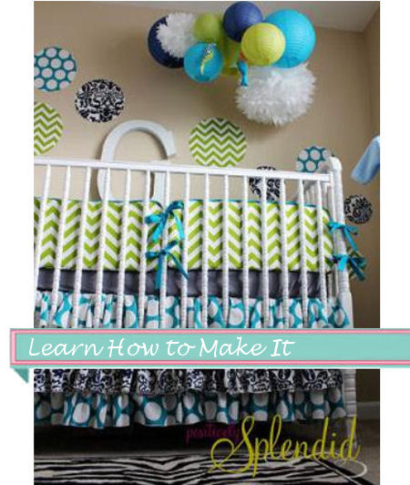 Baby boy or girl nursery with ruffled crib skirt paper lanterns and fabric polka dots wall decorations