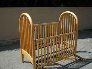 Natural Wood finish Simmons Little Folks Baby Crib with a Drop Side