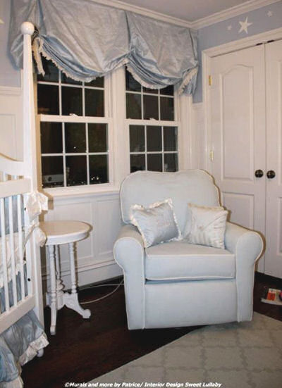 Baby blue and white reading area in a boy nursery