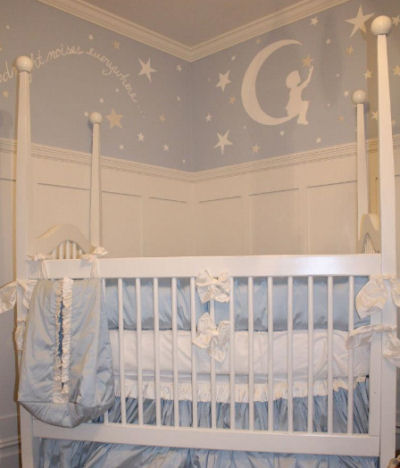 White and light baby blue boy nursery with a Goodnight Moon and stars wall mural