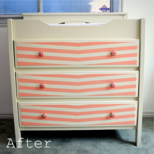 Peach and ivory baby girl nursery changing table dresser combination with Anthropologie knobs drawer pulls