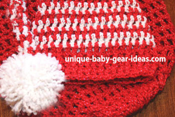White and red Christmas baby crochet hat and cocoon set crocheted in sparkling red and white glitter yarn