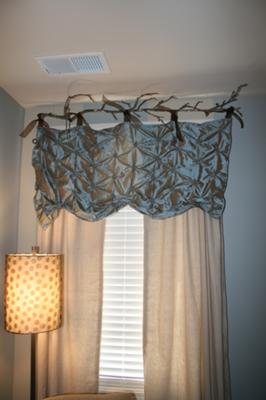 Nursery curtains that I made myself using silver, blue and ivory cream color fabric