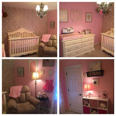 Our baby girl's nursery is elegantly decorated in pink with metallic gold damask wallpaper