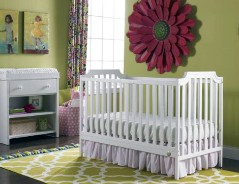 White pink and green baby nursery wall decor for a room with tall ceilings