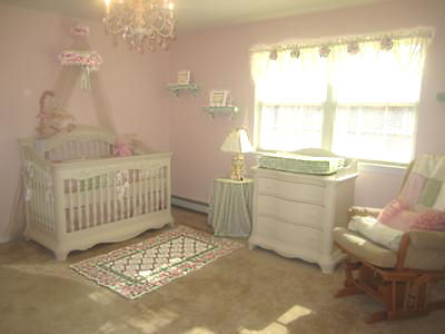 Pink white and sage green nursery for a baby princess