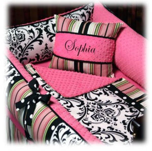 Custom personalized hot pink and black minky chenille baby bedding set with white accents stripes polka dots and damask fabric