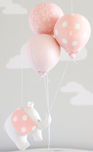 Homemade pink and white polka dot elephant hot air balloon baby crib mobile.