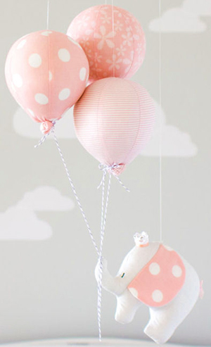 Homemade pink polka dots elephant baby mobile baby shower decorations.